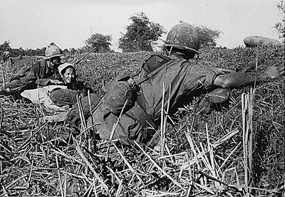 Soldiers in action defending civilians from the NVA